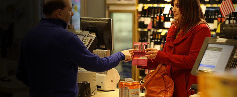 Man at store checking woman ID