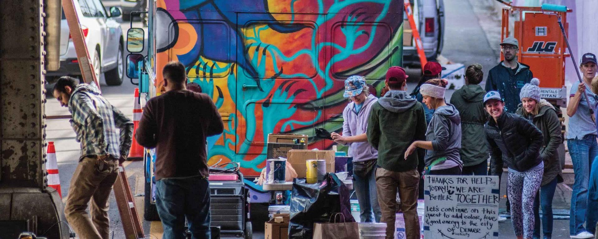 Volunteers painting a bus