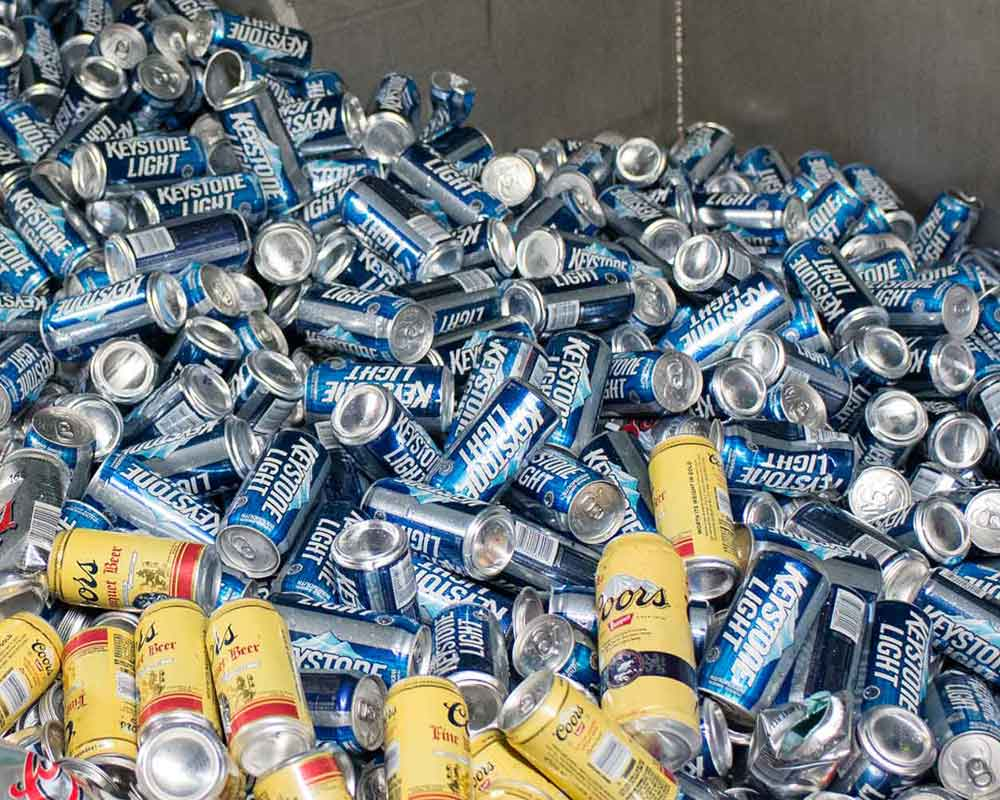 Coors and keystone light beer cans pile for recycling