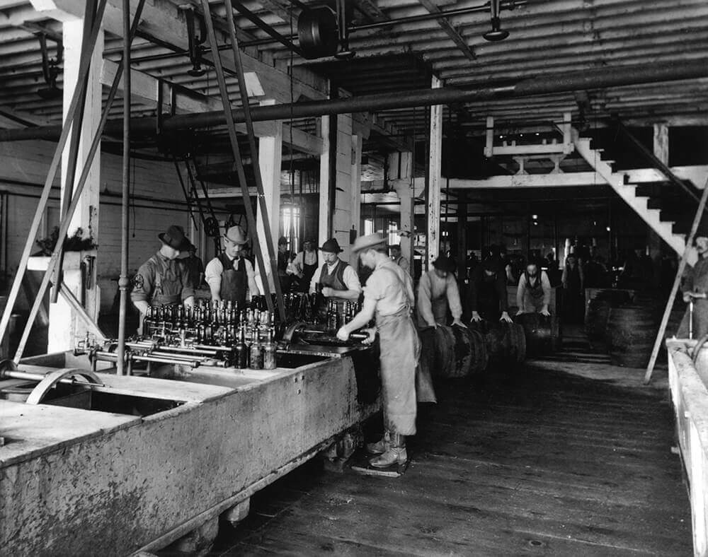 men working at Miller bottling factory