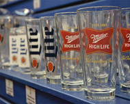 Glass with miller lite brands logo